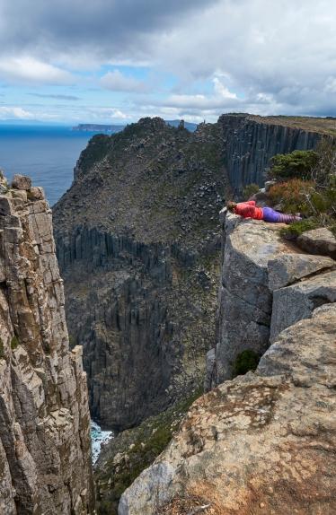 Looking over the brink on the Three Capes Walk, on the Tasman Peninsula, southeast Tasmania.